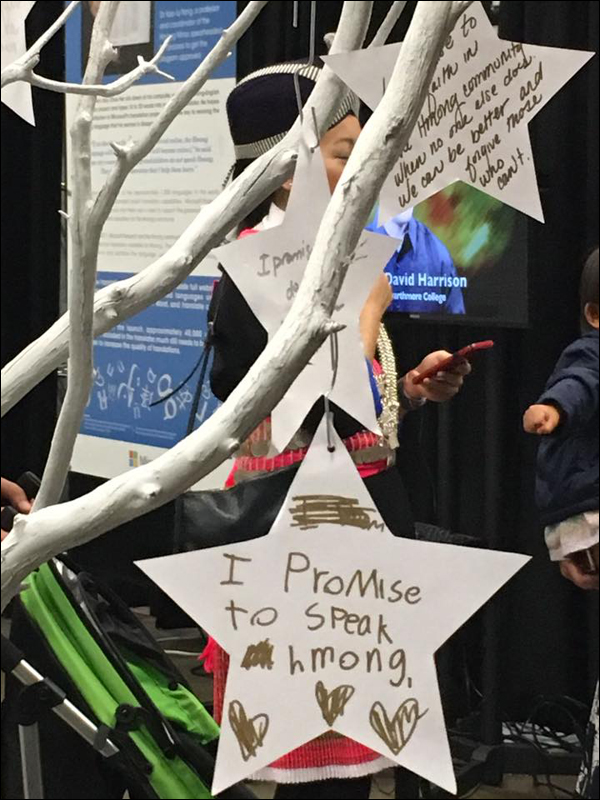 A table inviting exhibit attendees to leave a written promise to future generations