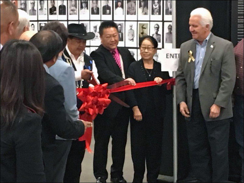 Ribbon cutting with representatives from the first three Hmong families to arrive in Merced, CA