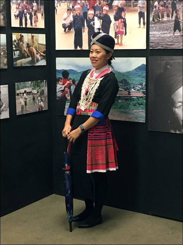 Beautiful Hmong woman posing for photos with her family.