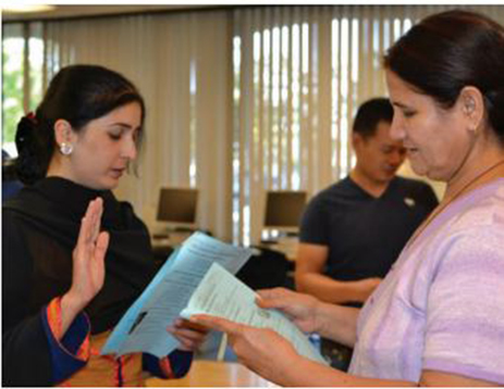 Photo of students practicing taking their US citizenship oath
