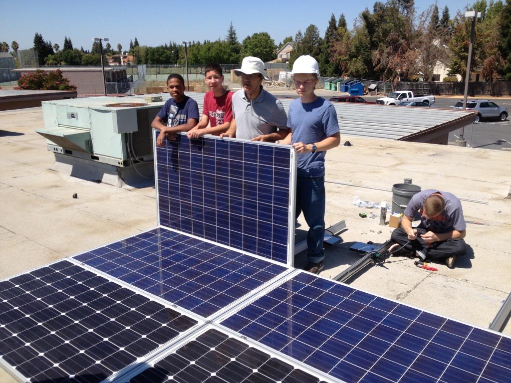 GETA Students installing solar panels at Laguna Creek High School.