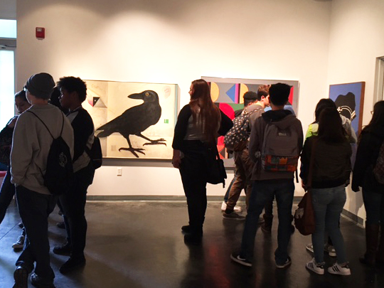 Students observing Art Gallery at Sac City College.