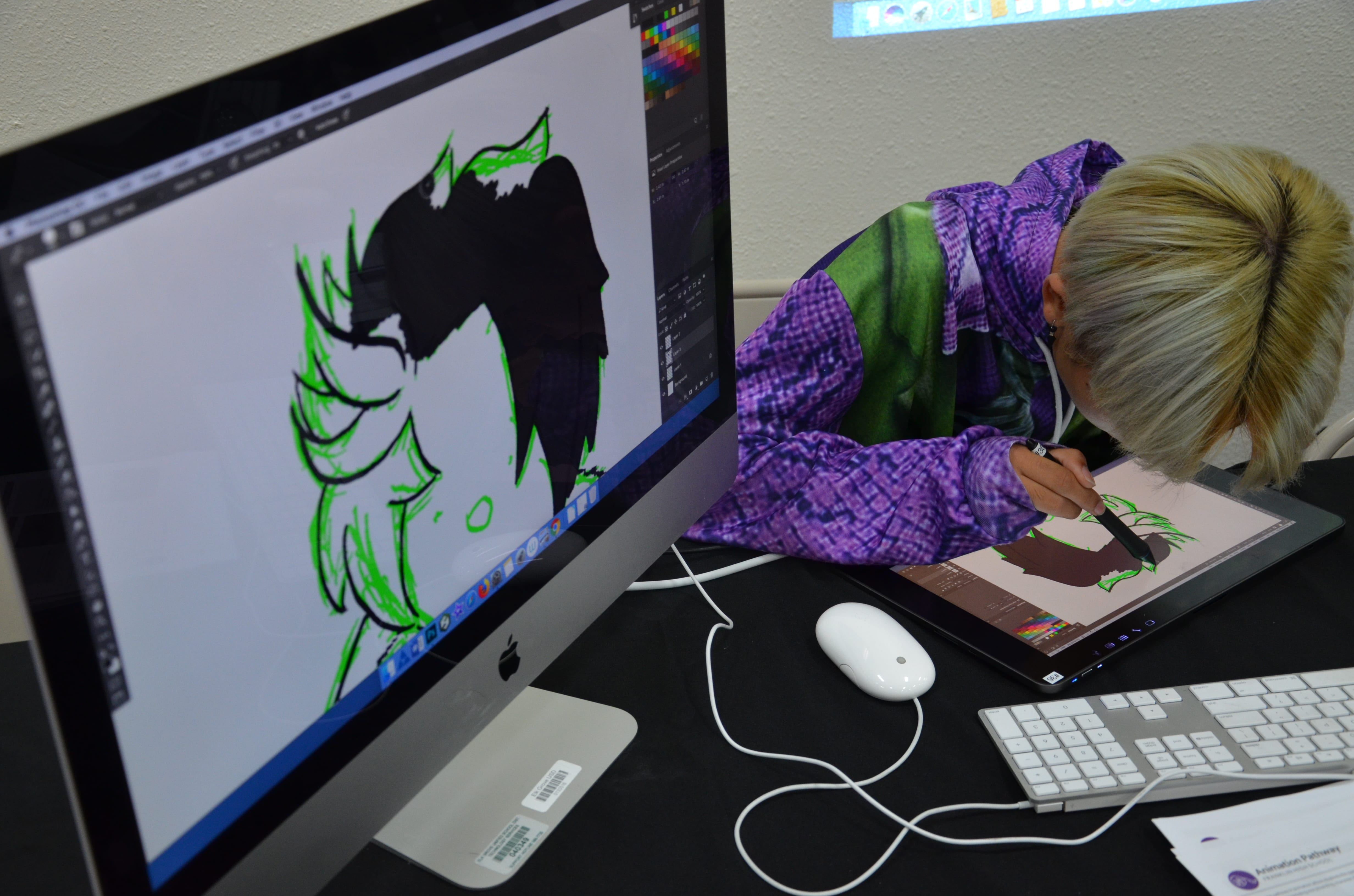 Taking a peek while a Sheldon High School Animation student draws.