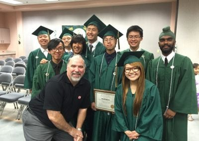 Skip Brewer with CyberPatriot students at graduation