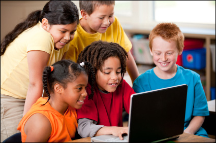Children using a laptop computer in the classroom
