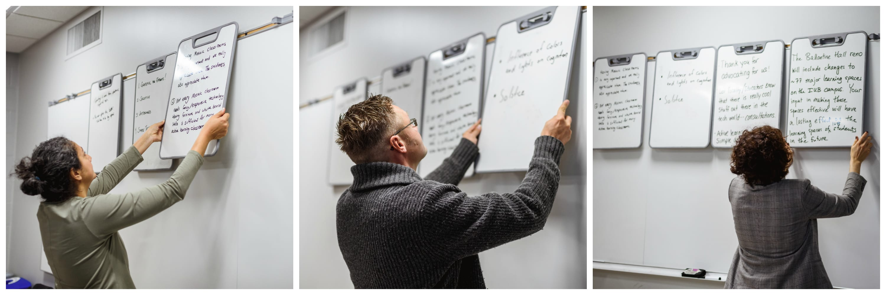 Mosaic Faculty Fellows hang verb boards with feedback along wall for all to see