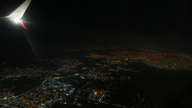 Photo taken taken at night from airplane window soon after takeoff from Mexico City to Monterrey, Mexico, January 18, 2018