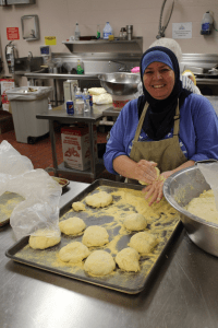 Subhiya, a long-time member of the ICGT, bakes bread for the International Festival