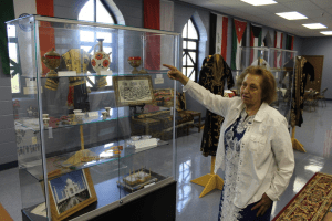 Dr. Fatima Al-Hayani explains the history of the ICGT's collection of cultural artifacts.