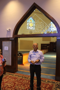 Dr. Abdul-Rahman Soliman leads a tour of the mosque and prayer area for visitors during the 2019 International Festival.