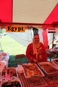 ICGT members serve up traditional food representing their countries of origin at the International Festival. Here, an Egyptian woman sells koshari and other Egyptian dishes.