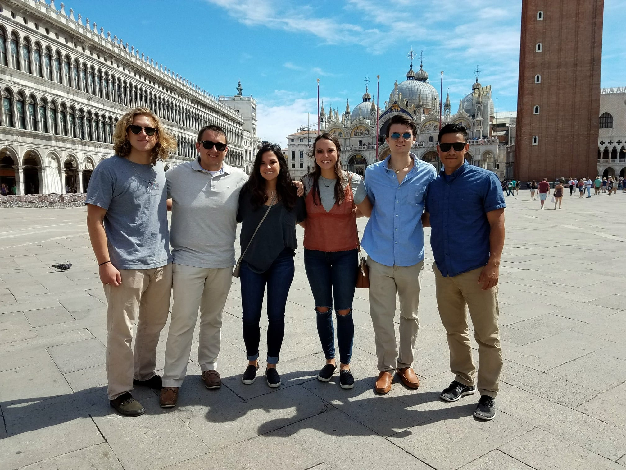 SPEA students studying abroad standing in a plaza in Venice.