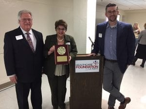 Healthcare Foundation of La Porte's Jeff Bernel and Maria Fruth stand with program graduate Pastor Nate Loucks upon completion of the Executive Education Nonprofit Leadership Academy.