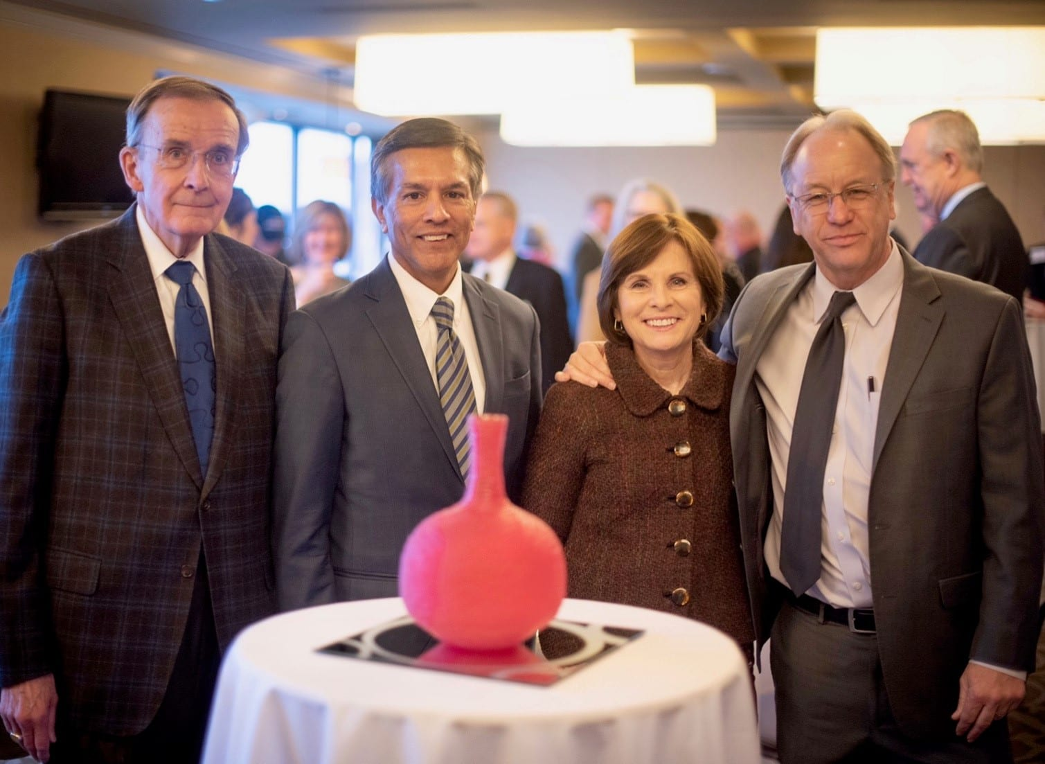 Moira Carlsted stands with the John L. Krauss award--a handmade glass sculpture from local artist Ben Johnson--at the O'Neill School's Champions of Public Policy event. Carlstedt is pictured below (L-R) with John Krauss, PPI director Thomas Guevara, and Brain Payne, President and CEO of the Central Indiana Community Foundation.