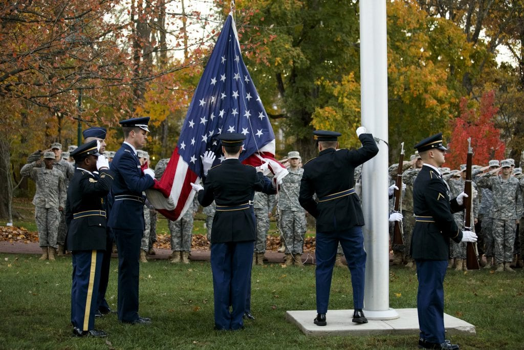 A joint cadet color guard raises the flag during a Veteran's Day ceremony outside of Franklin Hall at Indiana University Bloomington on Friday, Nov. 11, 2016.