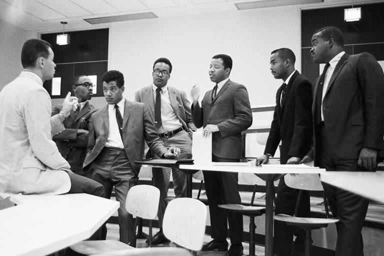 Members of IU's inaugural class in a 1968 meeting with faculty member