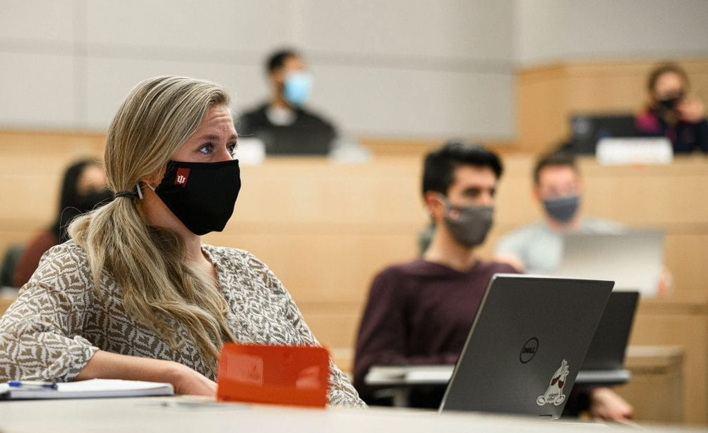 Photos of Full-Time MBA students wearing face masks and social distancing in the classroom were taken on October 6, 2020.