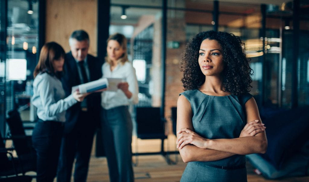 african-american ethnicity woman standing confidently in office looking away