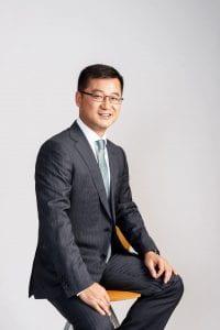 Ming Mei sitting on a stool