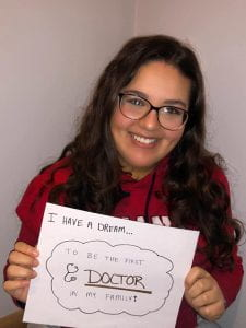 "Engage intern Rana Hamad holding a sign that says ""I have a dream...to be the first doctor in my family!"""