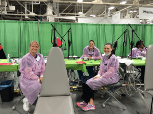 Dr. Carmen Dielman with two former students (Shay Skene and Shelby Vaughn) at the Indiana Missions of Mercy Free Dental Care event at the Indiana State Fairgrounds where over 700 patients received free dental care in a two-day event.