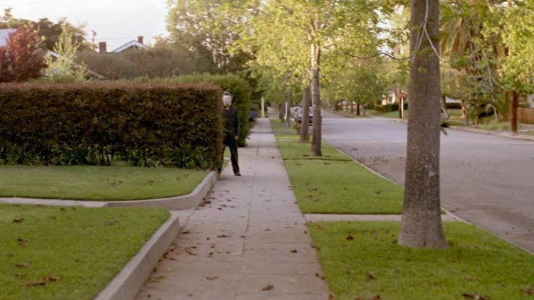Michael Myers behind a bush