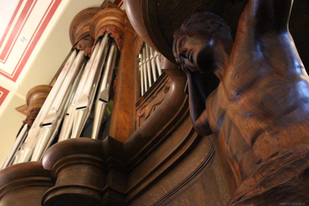 Carving details on organ.
