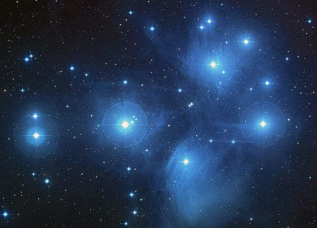 The Pleiades star cluster, containing several distinctly bright stars