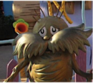 A picture of a statue of the Lorax