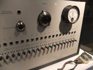 Metal box with many switches and dials, supposedly used to shock participants.