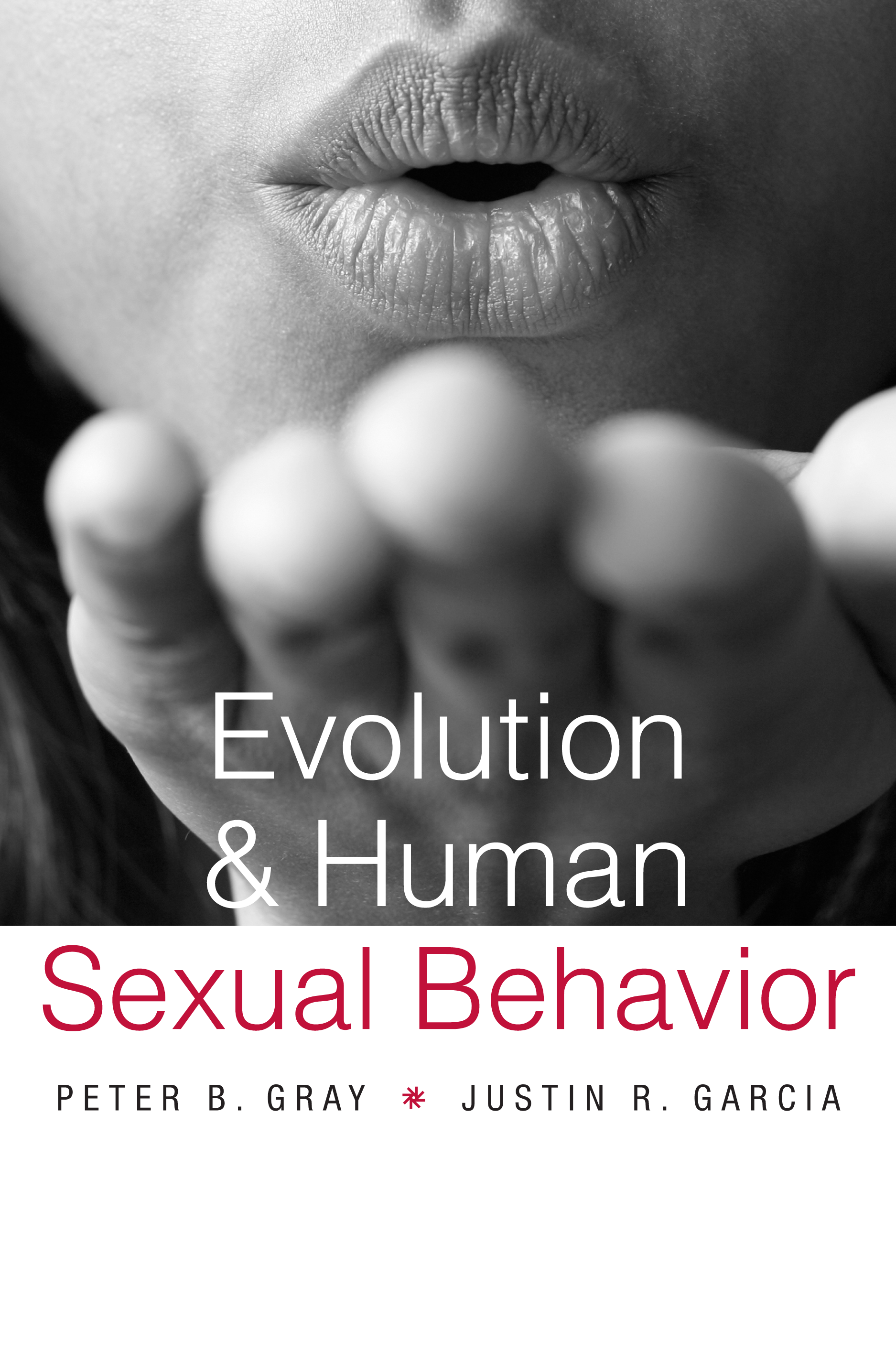 The cover of Evolution & Human Sexual Behavior, edited by Peter Gray and Justin Garcia (2013). The color image is a black and white picture of the lower half of a light skinned woman's face blowing a kiss at the camera.