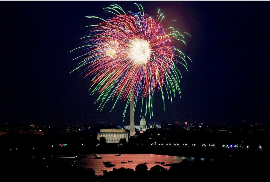 Colorful fireworks exploding over US national monuments.