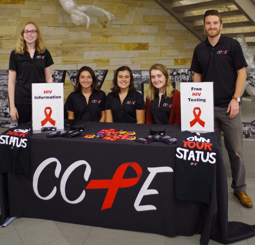 Portrait of CCPE staff and interns at an HIV testing event at Ivy Tech's Bloomington Campus in Fall 2017. From left to right: Audrey White (Outreach Specialist), Ashley Judge (2016 intern), Sydney Whiteford (2016 intern), Lynette Crick (2017 intern), and Matthew Clay (Program Director)
