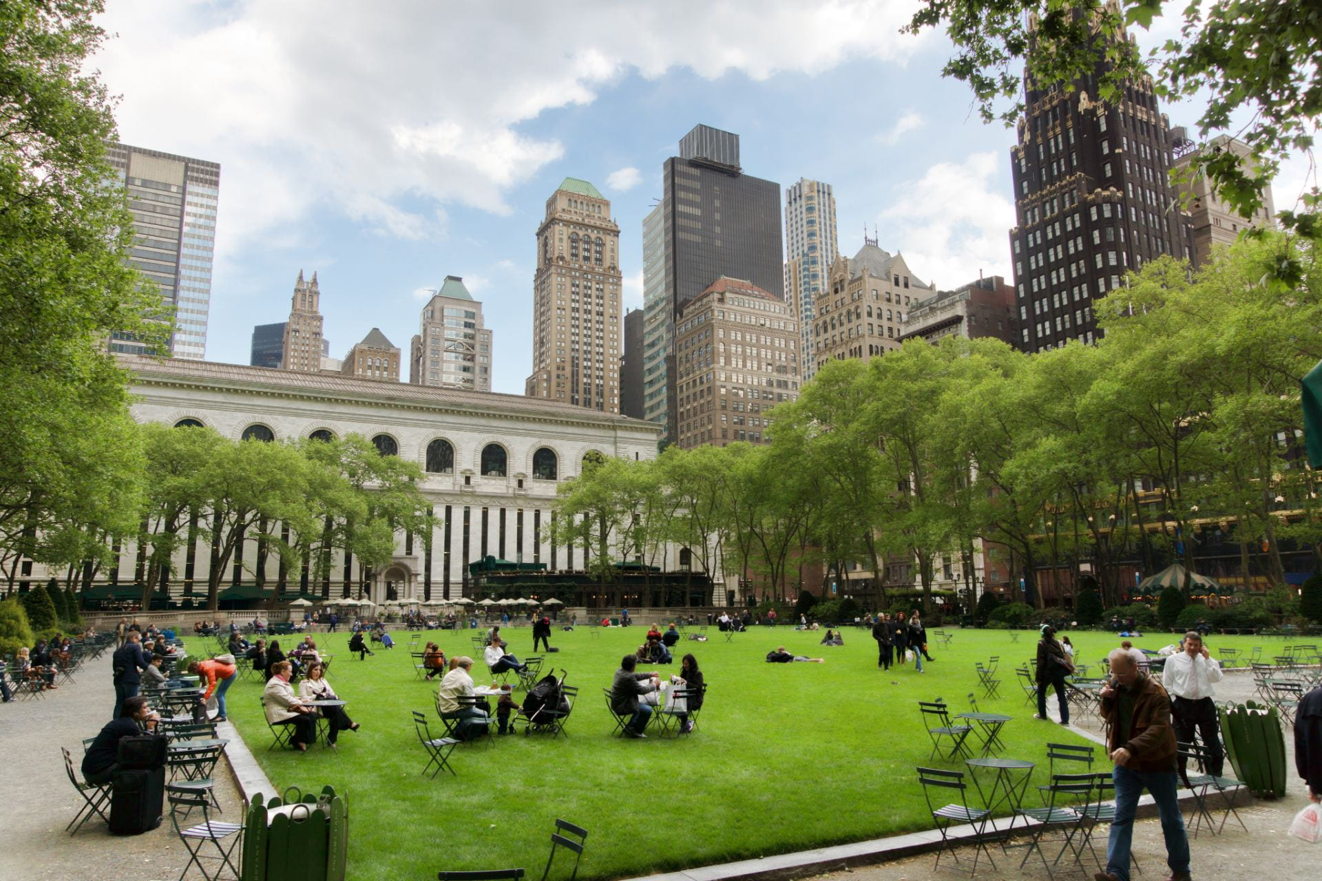 An image of people enjoying green spaces in Bryant Park in New York City