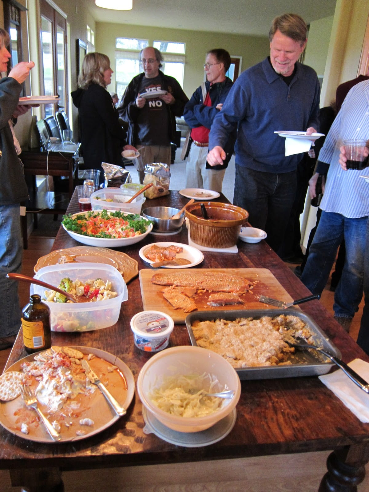 A group of people enjoying a potluck gathering.