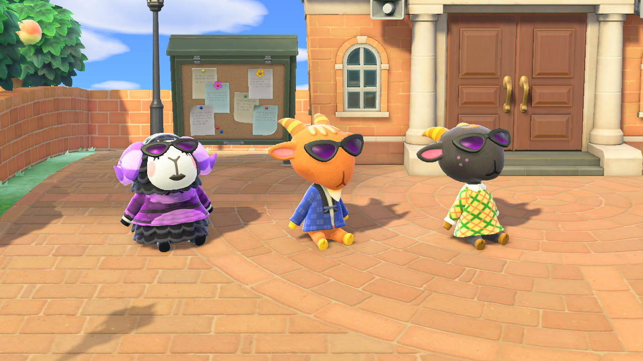 [image showing three animal crossing characters in the town square.]