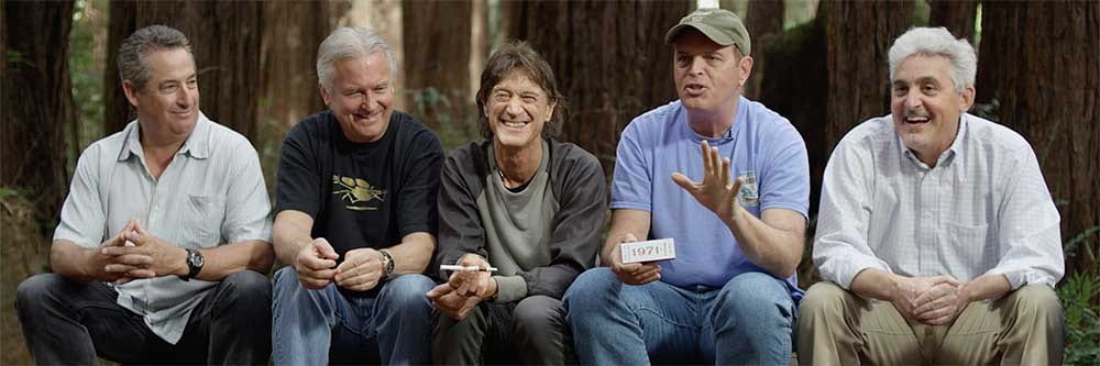 The five founders of 420 sitting in the woods together.