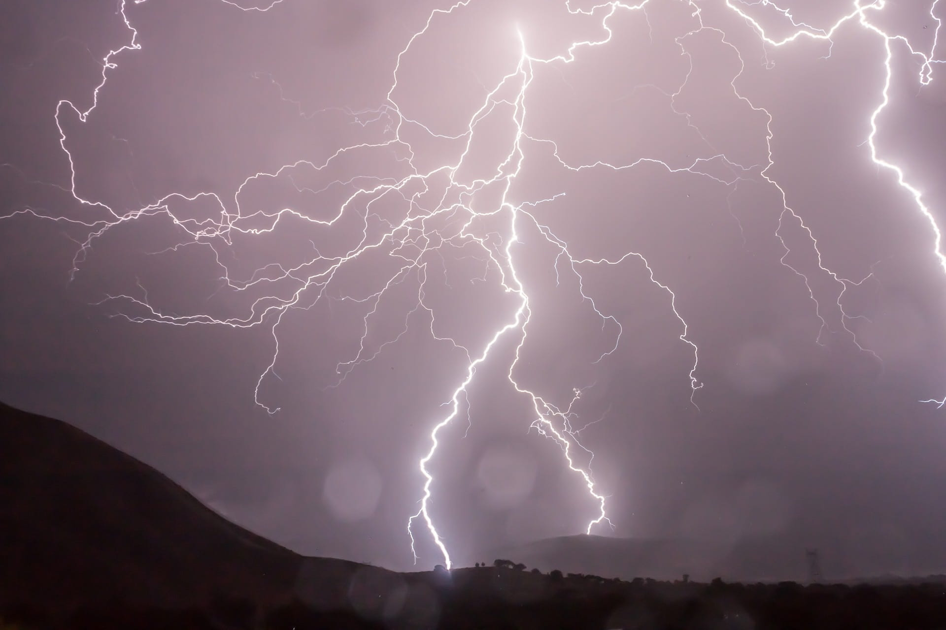 Image of lightning during a thunderstorm. The lightning represents the irregular electrical activity occurring in the brain of an individual with epilepsy.