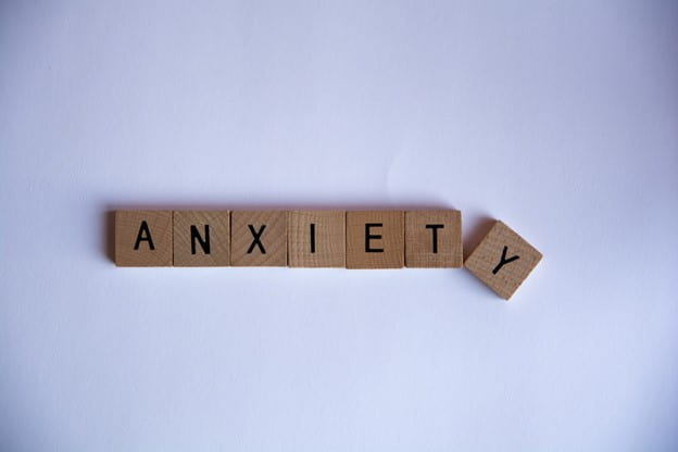 [Scrabble tiles spell the word anxiety.]