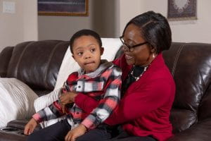 Dr. Agbasi sitting with her young son, Daniel, on her lap.