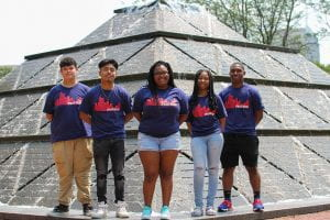 Five Upward Bound students stand in front of the pyramid fountain on the IUPUI campus.