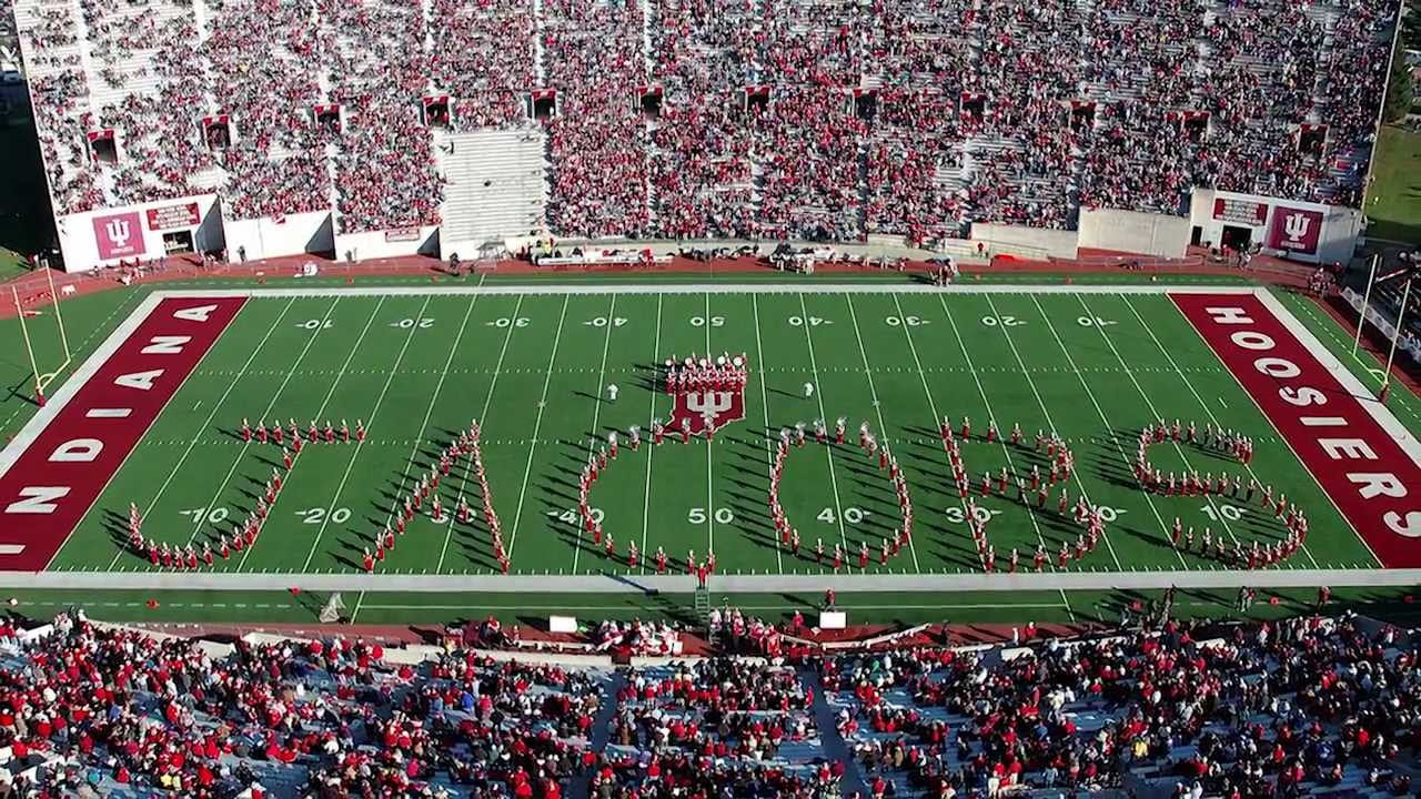 Marching hundred spells out the word Jacobs on IU memorial stadium field.