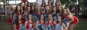 dance team group, all smiling together with pom poms