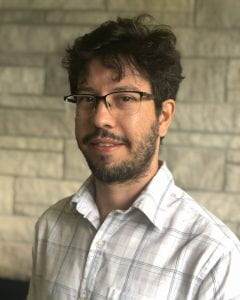 A photo of a young man with glasses. The man is Filipi Silva, a research scientist at IUNI.