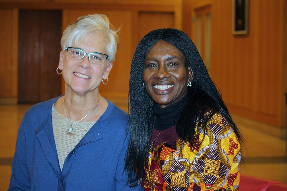Sara Johnson and Ngozi Iwere standing together after a presentation.