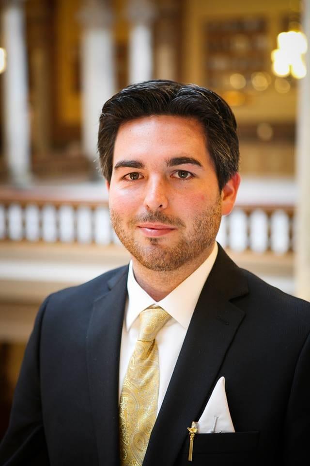 Headshot of Jordan Lett inside the Indiana Statehouse