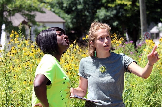 SPEA's Gifty Adusei (L) and Keep Indianapolis Beautiful's Kelly DeRolf (R) look at the health of plants and trees in a community green space on the south side of Indianapolis