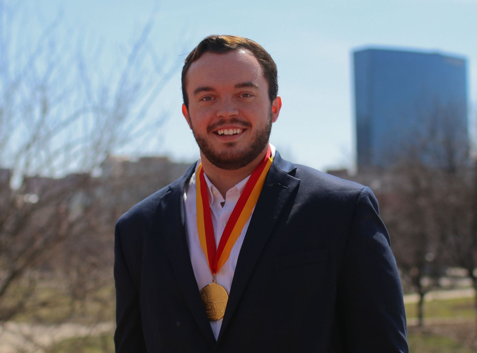 O'Neill's Matt Watkins wears the William M. Plater Civic Engagement Medallion.