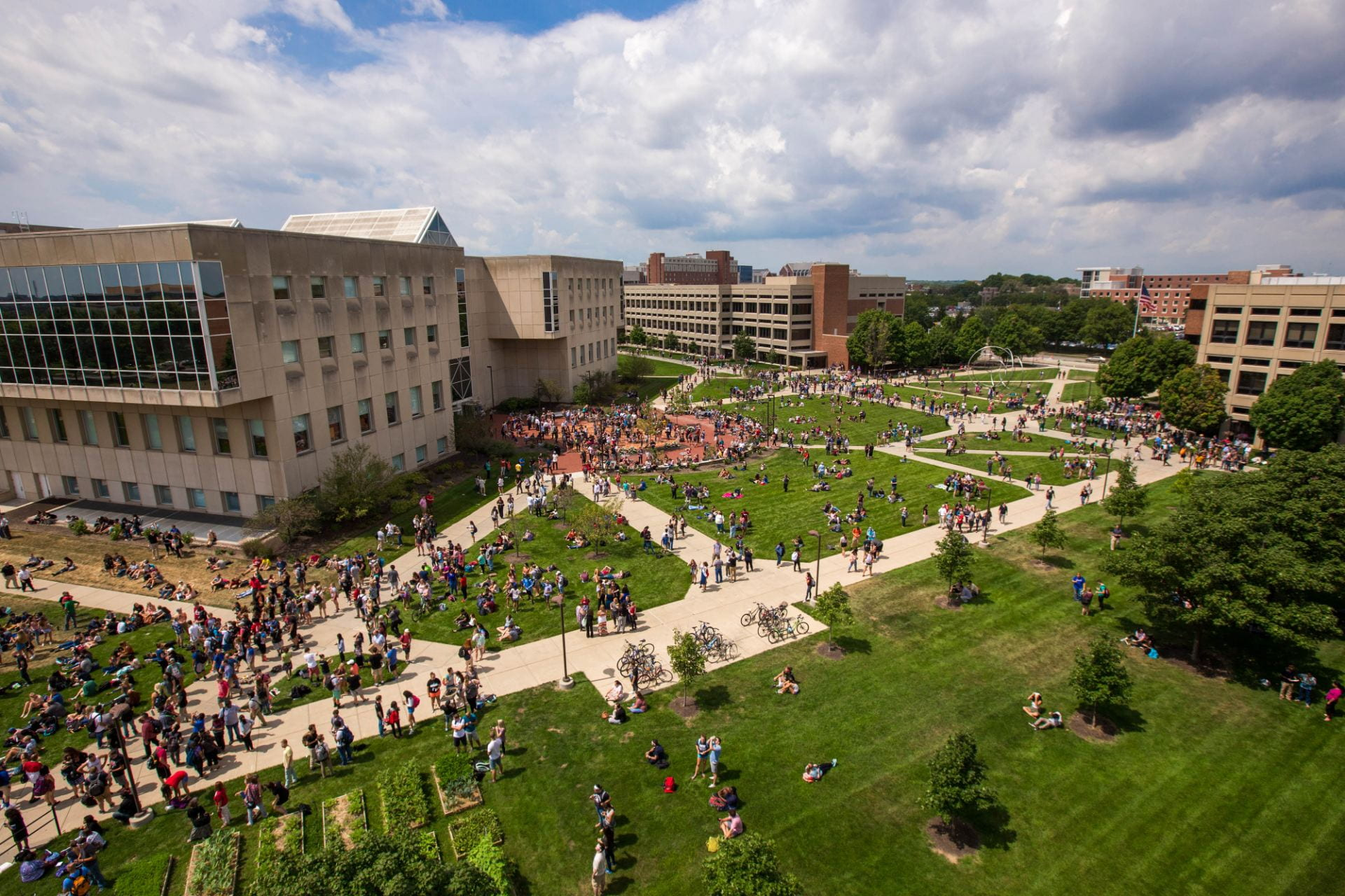wide aerial shot of students walking around on campus.