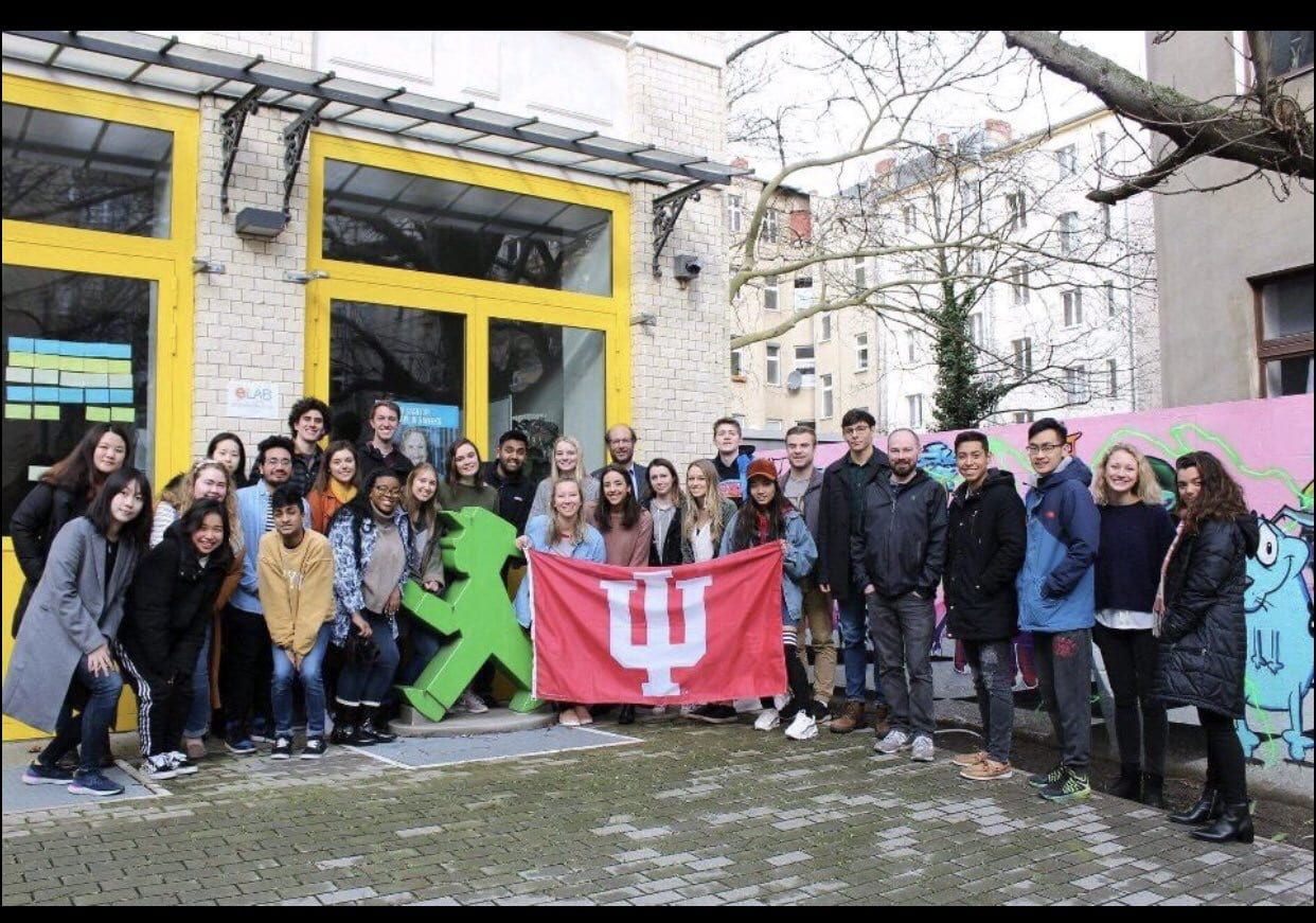 Group of students pose with IU flag in Berlin
